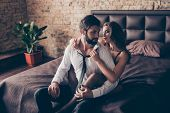 Stunning Brunette Embracing Her Lover From The Back, He Is Bearded Handsome Brunet In A Formal Wear, poster