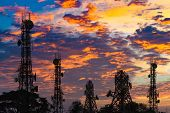 Silhouette Of The Antenna Of Cellular Cell Phone And Communication System Tower On Cloud And Blue Sk poster