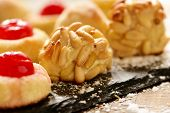closeup of some panellets, typical confection eaten in All Saints Day in Catalonia, Spain, on a wood poster
