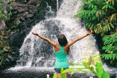 Hawaii travel nature waterfall woman hiker at Canyon Trail Waipoo Falls in Waimea, Kauai island, USA poster