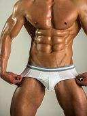 Mens Fashion Underwear. Strong Naked Man Shows His Panties On The Body. Athlete With Muscles Advert poster