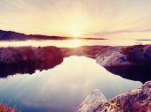 Beautiful Seascape. Mirroring Of  Sunset In Water Pools In The Rocks . Smooth Ocean poster