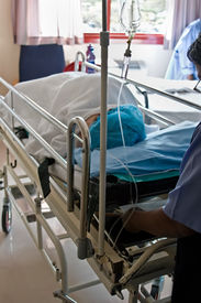 stock photo of life-support  - Healthcare personnel carry one patient after surgery in the recovery room - JPG