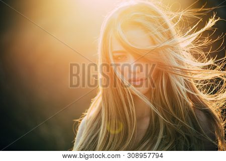 poster of Adding Volume To Her Long Hair. Sensual Woman With Wavy Long Hair Outdoor. Pretty Girl With Beautifu