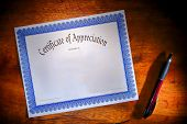 Certificate Of Appreciation Blank Document On Desk