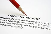 stock photo of deed  - Close up of pencil on Debt settlement - JPG