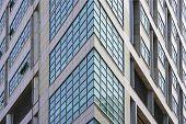 Angle Modern Business Building Skyscraper Blue Glass Windows. Windows Of Facade. Modern Apartment Bu poster