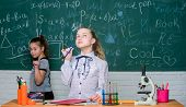 Little Girls Scientist Work With Microscope. Little Girls In School Lab. Science Is Future. Chemistr poster