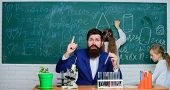 Man Bearded Teacher Work With Microscope And Test Tubes In Biology Classroom. School Teacher Of Biol poster