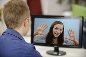 stock photo of long distance  - Young couple having a video conference - JPG