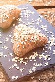 Vegan Oatmeal Buns. Proper Healthy Diet. Homemade Farm Cakes. Homemade Triangular Bread For Sandwich poster