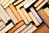 Many Books Piles. Hardback Books On Wooden Table. Back To School. Copy Space - Image poster