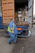 The lorry drive closes the doors of the container that is taking donated books to Ghana