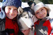 Children And Husky Dog