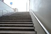 The Modern Exit From The Pedestrian Tunnel Is Empty, Up The Stairs. Staircase Up To The Street From  poster