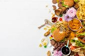 Fast Food Dish On White Background. Take Away Unhealthy Set Including Burgers, Sauces, French Fries, poster