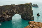 Dyrholaey Rock Arch In The Atlantic Ocean, Iceland poster