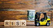 Wooden Blocks With The Word Risk, Money And A Forklift. Financial And Commercial Risk Concept. Inves poster