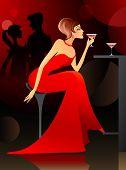 Woman Having Cocktail At The Bar