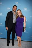 LOS ANGELES - MAR 10:  Bobby Ghassemieh; Jennifer Gareis arrives at the Bold and Beautiful 25th Anni