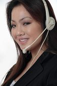 Attractive Receptionist Wearing Headset poster