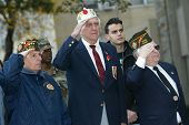 NEW YORK - NOVEMBER 11: War veterans of Whitestone salute at a Veteran's Day Memorial service at St. John's University November 11, 2005 in Queens, NY.