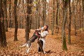 Unconditional Love. Girl Enjoy Walk With Husky Dog. Siberian Husky Favorite Pet. Animal Husbandry. G poster