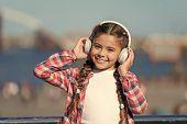 Adorable Music Lover. Little Kid Enjoy Listening To Music. Little Girl Wearing Stereo Headphones. Li poster