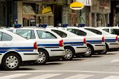 picture of police lineup  - police patrol automobiles on streets of zagreb croatia - JPG