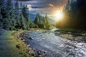 Day And Night Time Change Concept Above Mountain River In Forest. Beautiful Nature Scenery In Autumn poster