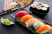 stock photo of chopsticks  - sushi and rolls - JPG