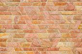 pic of trapezoid  - pattern color of modern style design decorative red slate stone wall surface with cement in trapezoid shape - JPG