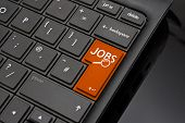 picture of qwerty  - Job search Return Key symbolizing the searching of internet recruitment websites to find work or a job by an applicant - JPG