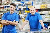two seller assistant men in DIY hardware or home improvement store supermarket