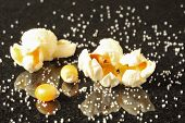 Popcorn Kernels Surrounded By Salt Grains
