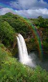 Waterfall In Kauai Hawaii With Rainbow