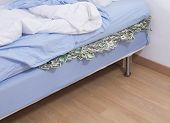 stock photo of mattress  - Savings or bank run concept - JPG