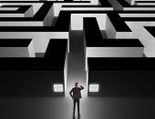 foto of solution problem  - Business man in front of a huge maze thinking how to get through - JPG