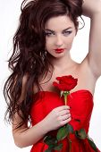 Portrait Of Beautiful Brunette Woman Holding Red Rose