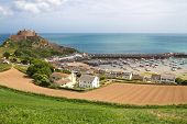 View to Mont Orgueil Castle with harbour in Gorey on Jersey, UK