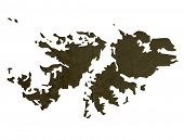 Dark silhouetted and textured map of Falkland Islands isolated on white background.
