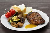 stock photo of beef wellington  - pork steak with sauce mustard and grilled vegetables on the plate - JPG
