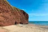 Red rock beach near Dawlish Warren Devon England UK