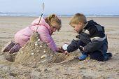 Children Building Sand Castle.