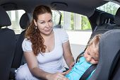 Mom Wakes Up Sleeping Daughter In A Car Safety Seat