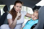 Mother Showing Shh Gesture When Child Asleep In Car