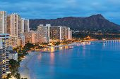 stock photo of volcanic  - Scenic view of Honolulu city Diamond Head and Waikiki Beach at night - JPG