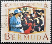 BERMUDA - CIRCA 1997: A stamp printed in Bermuda shows Queen Elizabeth II golden wedding circa 1997