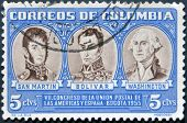 A stamp printed in Colombia shows San Martin Simon Bolivar and George Washington