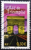 France - Circa 2003: A Stamp Printed In France Shows The Triumphal Arch At Night, Circa 2003